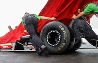 Aug 20, 2016; Brainerd, MN, USA; Rain falls as crew members move the dragster of NHRA top fuel driver Terry McMillen during a rain delay to qualifying for the Lucas Oil Nationals at Brainerd International Raceway. Mandatory Credit: Mark J. Rebilas-USA TODAY Sports