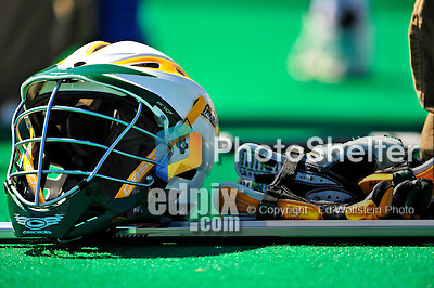 19 April 2009: A UVM lacrosse helmet and gauntlet rest on the turf at half time of a game between the University of Vermont Catamounts and the University at Albany Great Dames on Moulton Winder Field in Burlington, Vermont. The Cats fell to the Danes 9-6 in Vermont's last home game of the 2009 season. Mandatory Photo Credit: Ed Wolfstein Photo