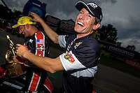 Sept. 1, 2014; Clermont, IN, USA; NHRA pro stock motorcycle rider Steve Johnson (right) congratulates Eddie Krawiec after winning the US Nationals at Lucas Oil Raceway. Mandatory Credit: Mark J. Rebilas-USA TODAY Sports