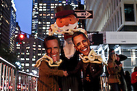 Women disguised as Mitt Romney and Barack Obama takes part during a protest out side Waldorf-Astoria Hotel, the venue for the 67th Annual Alfred E. Smith Memorial Foundation Dinner in New York, United States. 18/10/2012. by Kena Betancur / VIEWpress.