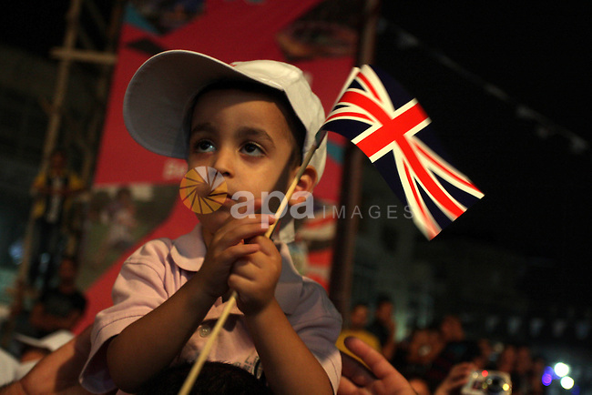 Palestinians celebrate of the opening Olympics Games in London, on July 27, 2012, in the West Bank city of Ramallah. Photo by Issam Rimawi