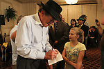 Gatewood Galbraith signed an autograph for 11 year old Atlanta Harrison after conceding the 2011Kentucky governor's race to Steve Beshear at the Crowne Plaza hotel in Lexington, Ky., on Tuesday, Nov. 8, 2011. Photo by Latara Appleby | Staff ..