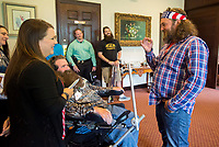 NWA Democrat-Gazette/JASON IVESTER<br /> Reality tv star Willie Robertson (from right) chats with Steve Swope and his wife Jackie Swope, both of Rogers, Wednesday, May 17, 2017, following the Arkansas Chapter of the ALS Association Breakfast at Pinnacle Country Club in Rogers. Steve Swope was diagnosed with Amyotrophic Lateral Sclerosis in 2008.