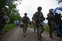 Brigadier General Lawrence E. Dudney Jr. (second from right) walks as members of the Georgia Army National Guard's 48th Brigade, 148th Brigade Support Battalion, train in an attack and medical evacuation scenario during a media visit day at Camp Atterbury, Indiana on Wednesday, June 3, 2009. Dudney is the commanding general of Task Force Phoenix. The brigade's upcoming overseas mission is to train the Afghan National Army and Police forces.