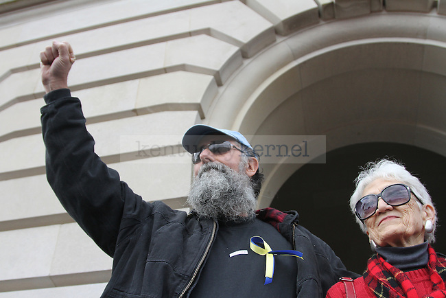 "Protester Doug Doerrfeld raises his fist to the crowd of cheering fans who came out to ""I love mountains"" day, on Feb. 14, 2011. Photo by Brandon Goodwin