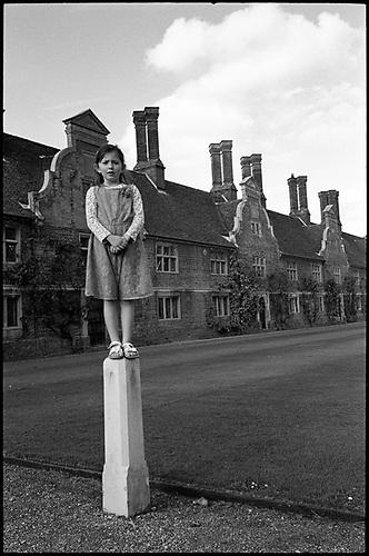 Girl on Pillar, Blickling Estate, Norfolk by Paul Cooklin