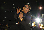 Lead singer of U2 and activist Bono performs prior to the Atlanta Falcons-New Orleans Saints football game at the newly re-opened Louisiana Superdome in New Orleans on Monday, Sept. 25, 2006. (Photo/Suzi Altman)