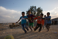Bedouin boys from the tribe of El-Azazme play soccer in their vilage in Ramat Beqa next to the City of Beer Sheva   Photo by Oren Nahshon
