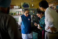 Dr. Vandana Shiva (second from right) shows different grains and seeds to the Minister of Environment, Sr. Jairam Ramesh, in Navdanya office in Dehradun, Uttarakhand, India, on 6th September 2009...Dr. Vandana Shiva, the founder of Navdanya Foundation and Bijavidyapeeth, is a physicist turned environmentalist who campaigns against genetically modified food and teaches farmers to rely on indigenous farming methods.. .Photo by Suzanne Lee / For The National