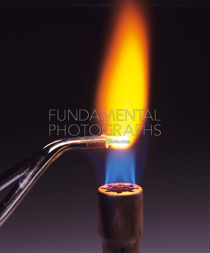 CALCIUM FLAME TEST<br /> Bright flame<br /> (3 of 3 - Variations Available)<br /> Calcium metal is held over Bunsen burner and burns with bright orange flame.
