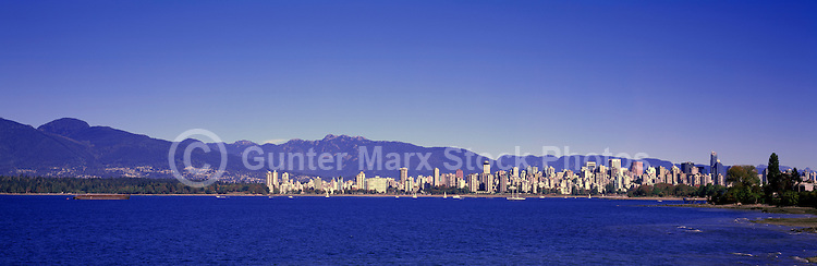 "City of Vancouver ""West End"" and Downtown Skyline at English Bay, BC, British Columbia, Canada, in Summer.  Stanley Park is to the left midground, and the North Shore Mountains (Coast Mountains) rise above the City. - Panoramic View"