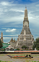 The Temple of Dawn, know to Thais as Wat Arun, was until recently the tallest building in the city, sited on the east bank of the Chao Phraya River. Towering above the river skyline like the limestone pillars of Phang Nga Bay, the Royal temple looks deceptively simple from a distance..