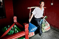 Early in the morning a farmer arrives with fresh produce for the kitchens of The West Lake Restaurant. Able to seat up to 5,000 people at one sitting, The West Lake Restaurant is the biggest Chinese restaurant in the world. Each week its diners, who staff are taught are 'the bringers of good fortune', devour 700 chickens, 200 snakes, 1,200 kgs of pork and 1,000 kgs of chillis. Its 300 chefs cook in five kitchens and its staff total more than 1,000.It is fully booked most nights.