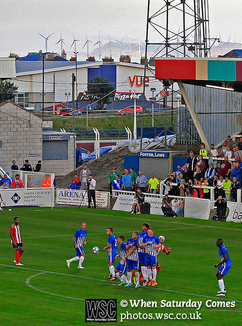 Hartlepool United 0 Sunderland 3, 20/07/2016. Victoria Park, Pre Season Friendly. Hartlepool United v Sunderland. Hartlepool defend a free kick. The wind turbines across the Tees estuary at Redcar are in the background. Photo by Paul Thompson.