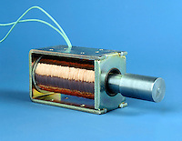 SOLENOID: MAGNETIC FIELD GENERATOR<br /> An Inductor Formed By Helical Winding of Wire<br /> A solenoid uses electromagnetism produced by current flow to operate a mechanical device. When energized the iron plunger in the center of the windings is drawn inward allowing the flow of air or liquid.