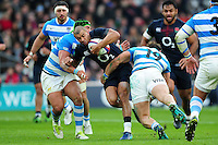Jonathan Joseph of England takes on the Argentina defence. Old Mutual Wealth Series International match between England and Argentina on November 26, 2016 at Twickenham Stadium in London, England. Photo by: Patrick Khachfe / Onside Images