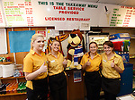 Staff in the Forres fish and chip shop with their Rangers dog behind the counter