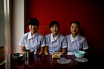 Restaurant workers take their lunch break at a newly opened restaurant name after the Olympic Games in Beijing, China on Monday, August 4, 2008. The city of Beijing is gearing up for the opening ceremonies of the Olympic Games.  Kevin German