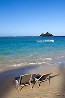 Beach chairs on deserted beach, Hawaii