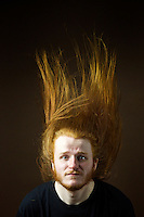 Calum McCruden, 21, Student of Applied Maths, from Glasgow.<br /> <br /> 'If it's really really sunny, it's vibrant ginger but in the winter time it's a darker colour. It changes with the seasons. The long hair I have had for the last 5 years. It's really warm during winter but it's a bit of a hassle to deal with sometimes. Useful at gigs for friends to spot me in the crowd.'  <br /> <br /> 'I went to my first metal gig when I was in third year at high school and saw some people head banging and thought Oh, I want to do that!. Long hair also saves a fortune on hair cuts, it used to be down to my waist. I have been growing it for 6 years, got 6 inches cut off a few months ago. I have been told since [that] if I had kept the cuttings it will be worth a lot of money for use in wigs, especially if you cut it long.'<br /> <br /> 'You get noticed by the oppostie sex, really odd. You start chatting about hair care products. Strangest line of conversation, I would never have this conversation with a dude but with you its fine. Eventually it almost always goes onto hair care products. I have been on nights out before where I have had random people come up and braid my hair. So I just sit there while they do it.'<br /> <br /> 'When you are starting off you need to do it for short intervals. Head-banging is just moving your head up and down or in a circle and if you have short hair it looks nice. I have clashed heads with people and seen them on the floor and been like I am so sorry. I can do it for long periods of time, up and down I can do forever. Round and round I can only do it for a minute of two.'<br /> <br /> 'Every ginger person I have met is really quite nice. Generally they are nice people. I feel more Scottish being ginger. You get people trying weegie (Glasgow) accents when you are on holiday. Once I graduate I would shave my beard but I would try and keep it long for as long as possible.'