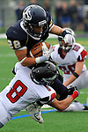 ICCP running back Randy Leslie punishes the Aurora Christian defender en route to a huge victory at Plunkett.