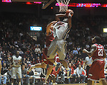 "Ole MIss forward Reginald Buckner (2)  is defended by Arkansas' Michael Sanchez (31) at C.M. ""Tad"" Smith in Oxford, Miss. on Saturday, March 5, 2010. Mississippi won 84-74."