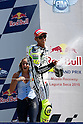 July 25, 2010 - Laguna Seca, USA - Fiat-Yamaha's Valentino Rossi celebrates getting third place on the podium after the U.S. Grand Prix held on July 25, 2010.  (Photo Andrew Northcott/Nippon News)