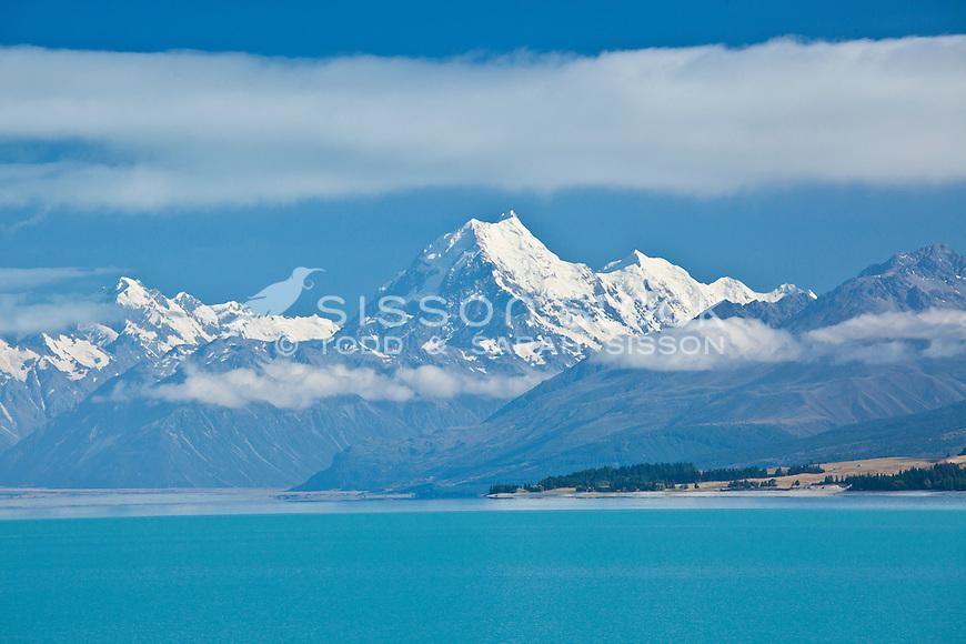 Looking across Lake Pukaki down to Mt Cook / Aoraki and Mt Tasman in summer, McKenzie Country, South Island, New Zealand.