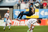 Sheanon Williams (25) of the Philadelphia Union goes over Mike Magee (18) of the Los Angeles Galaxy while going for a header. The Los Angeles Galaxy defeated the Philadelphia Union 4-1 during a Major League Soccer (MLS) match at PPL Park in Chester, PA, on May 15, 2013.