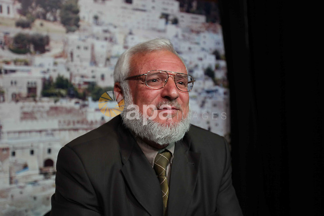 Hamas parliamentary speaker Aziz al-Dweik gives a televised speech from the West Bank city of Hebron on March 18, 2010. Dweik claimed that Palestinian security forces helped Israeli troops in trying to control angry Palestinians during the recent clashes and demonstrations against Israel's renovation of a synagogue in Jerusalem's Old City and plans to build new settlements.Photo by Najeh Hashlamoun
