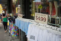 School uniforms for back-to-school are displayed outside of a store in the primarily Dominican New York neighborhood of Washington Heights on Sunday, August 12, 2012. (© Richard B. Levine)