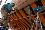 Shipwrights and volunteers work on a new phase of restoration of the Schooner Adventuress. She was originally launched in 1913 in Maine. They have replaced all the ribs on the starboard side and are replacing the planking with new mahogany planks. http://www.soundexp.org/
