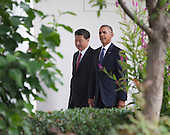 United States President Barack Obama and President XI Jinping of China walk to the Oval Office after participating in an official State Visit on the South Lawn of the White House in Washington, DC on Friday, September 25, 2015.<br /> Credit: Chris Kleponis / Pool via CNP