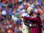 FSU head coach Jimbo Fisher has words with offensive lineman Cameron Erving after an unsportsman like conduct call in the 2nd half of the #2 ranked Florida State Seminoles 37-7 victory over the Florida Gators at Ben Hill Griffin Stadium in Gainesville, Florida November 30, 2013.  Florida State had an undefeated regular season at 12-0.