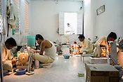 Workers making fine jewelry at the workshop at The Gem Palace in Jaipur, Rajasthan, India.