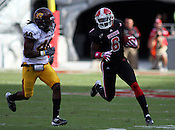 Wide reciever T.J. Graham runs past John Carr. NC State defeated Central Michigan 38-24 on Saturday, October 8, 2011 at Carter-Finley Stadium in Raleigh. Photo by Al Drago.
