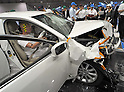 "July 21st, 2011, Susonosi, Japan - A Toyota Crown is badly damaged after a head-on collision with a Toyota VITZ at the speed of 55km/h (about 34 miles/h) in a demonstration at Toyotas Higashi-Fuji Technical Center on the foot of Mt. Fuji, some 92km (about 57 miles) southwest of Tokyo, on Thursday, July 21, 2011. Toyota showed to reporters technologies aimed at increasing safety for pedestrians and elderly drivers, as part of its initiatives to eliminate traffic casualties. The technologies include a Pre-Collision System with collision-avoidance assist, glare-preventing adaptive driving beams and a pop-up hood for lessening pedestrian injury. In the PCS, Toyota uses cameras and a super sensitive radar called ""millimeter-wave,"" both installed in the front of the vehicle, to detect possible crashes such as a pedestrian crossing the road. Then the vehicle calculates how braking and steering must be applied to avoid a crash. (Photo by Natsuki Sakai/AFLO) [3615] -mis-"