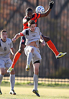 WASHINGTON, DC - NOVEMBER 25, 2012: Steve Neumann (18) of Georgetown University looses the ball to Jordan Murrell (4) of Syracuse University during an NCAA championship third round match at North Kehoe field, in Georgetown, Washington DC on November 25. Georgetown won 2-1 after overtime and penalty kicks.