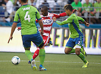 Fabian Castillo, left, of FC Dallas kicks the ball past DeAndre Yedlin during play at CenturyLink Field in Seattle Saturday August, 3, 2013. The Sounders defeated Dallas 3-0.