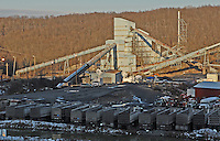 The sunset Saturday, Jan. 7, 2006, casts a warm glow across some of the cleaning facility buildings at the Buckhannon, WV, Sago mine where 12 miners died in an explosion. (Gary Gardiner/EyePush Newsphotos)<br />