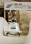 8 January 2016: Nikita Zakharov, piloting his 2-man bobsled for Russia, enters the Chicane straightaway on his first run, ending the day with a combined 2-run time of 1:52.16 and earning a 16th place finish at the BMW IBSF World Cup Championships at the Olympic Sports Track in Lake Placid, New York, USA. Mandatory Credit: Ed Wolfstein Photo *** RAW (NEF) Image File Available ***