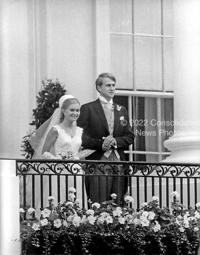"""Washington, DC - June 12, 1971 -- Tricia Nixon Cox, left, and her husband, Edward Cox, right, pose on the balcony of the South Portico of the White House in Washington, D.C. on Saturday, June 12, 1971 following their marriage in the Rose Garden.  More than 400 guests attended the dazzling affair..Credit: Benjamin E. """"Gene"""" Forte - CNP"""