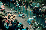 Grischa Janorschke from NetApp team lying on the ground after crashing at the beginning of the Forest of Arenberg, in the Paris Roubaix professional cycling race classic, won in 2012 by Belgian Tom Boonen - for the fourth time. The 256.5km race runs from Compiègne, near Paris, to Roubaix, northern France, crossing 51.5km of pavé - ancient cobblestones, along the way. Janorschke fell after puncturing on the cobbles, and reportedly fractured his elbow from the impact. Guillaume Van Keirsbulck is the rider standing up  on the left, while Guillaume Van Keirsbulck is attempting get back on his bike.