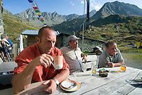 Neustift im Stubaital, Stubaier Hohenweg, Tirol, Austria, September 2008. Men and women overnight in the Franz Senn Hutte,  Hiking the Stubai High Trail from hut to hut in the southern Alps, we clear a mountain pass on a daily basis. Photo by Frits Meyst/Adventure4ever.com.