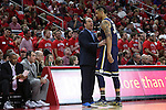 25 January 2015: Notre Dame head coach Mike Brey (left) talks to Zach Auguste (30). The North Carolina State University Wolfpack played the University of Notre Dame Fighting Irish in an NCAA Division I Men's basketball game at the PNC Arena in Raleigh, North Carolina. Notre Dame won the game 81-78 in overtime.