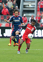 21 April 2012: Toronto FC midfielder Julian de Guzman #6 and Chicago Fire midfielder Daniel Paladini #11 in action during a game between the Chicago Fire and Toronto FC at BMO Field in Toronto..The Chicago Fire won 3-2....