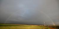 A rainbow stretches of a drill rig in North Dakota's Bakken oil field.