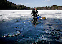 Steinar Schjager freediving under the ice at Lutvann lake,outside Oslo, Norway. Photo: Fredrik Naumann/Felix Features