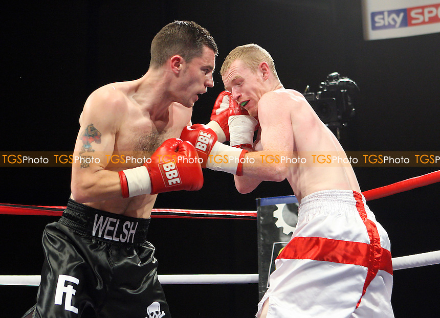 Martin Welsh (black shorts) defeats William Warburton in a Welterweight boxing contest at Goresbrook Leisure Centre, Dagenham, promoted by Frank Maloney - 14/05/10 - MANDATORY CREDIT: Gavin Ellis/TGSPHOTO - Self billing applies where appropriate - Tel: 0845 094 6026