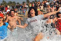 Swimmers run into the chilly Pacific Ocean during the 49th Annual Venice Penguin Swim on New Years Day-Thursday, January 1, 2009, at the Venice Beach Breakwater.  The 2008 Penguin Swim featured more than 80 participants, three-foot waves, and sunny  56° degree weather, with a water temperature of 54°degrees.